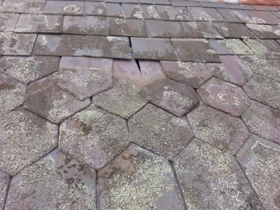 wind damaged slate roofing