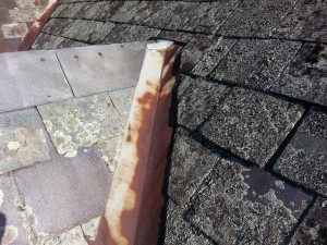 Rusted slate roof valleys need replacing in Brighton