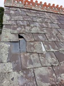 missing roof slate causing leaks Kew