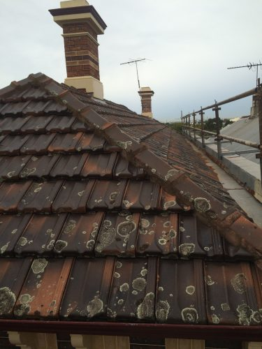slate roofing installed on tiles