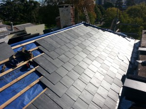 roof slates being laid