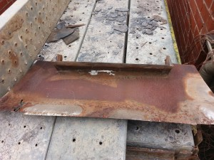 Slate roof chimney gutter rusted through and leaking.
