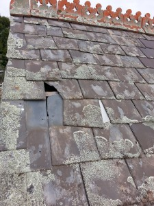 missing roof slate causing leaks Kew
