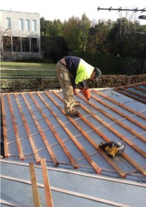 Battens being installed to the shallow pitch slate roof