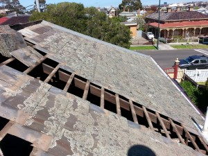 slate roof restoration by stripping and renailing slates